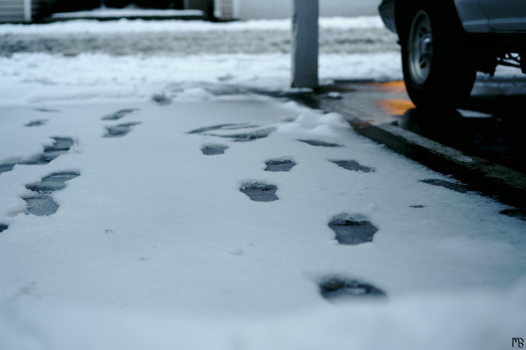 Steps in the snow near car