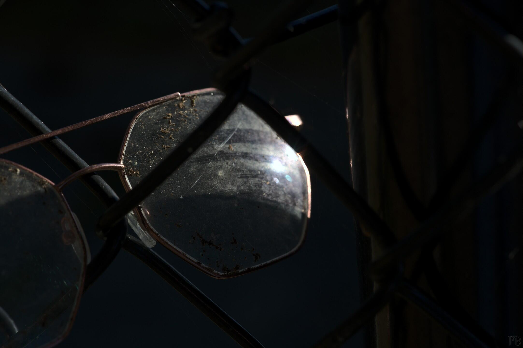 Glasses in a fence and sun